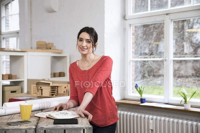 Woman standing in creative office — Stock Photo