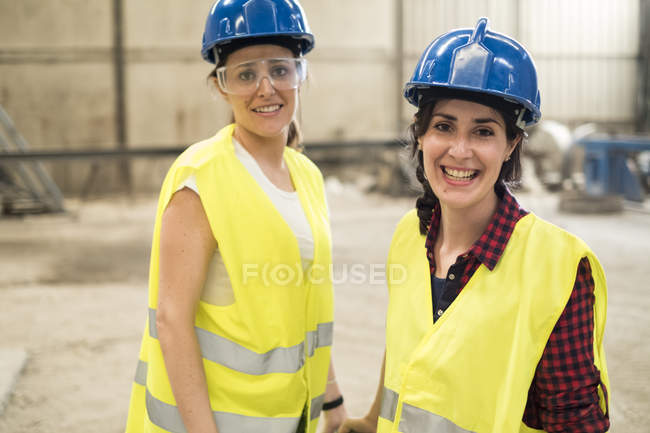 Female workers in concrete factory — Stock Photo