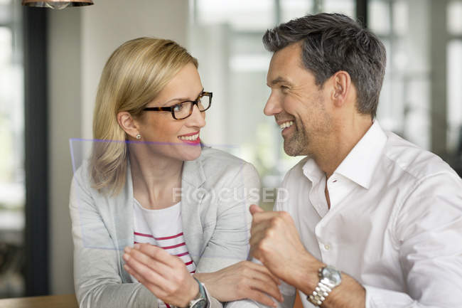 Businessman and woman with portable device — Stock Photo