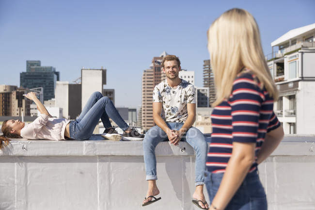 Friends spending time on rooftop terrace — Stock Photo