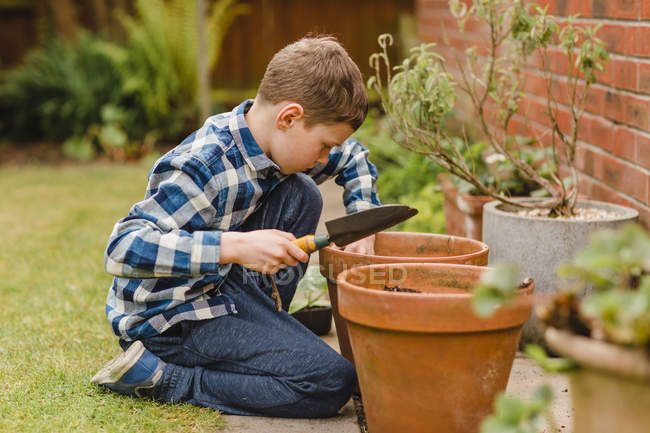 Boy planting and seeds — Stock Photo