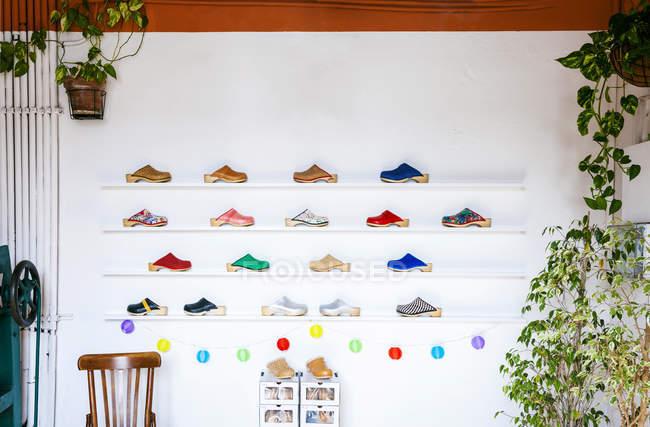 Assortment of clogs on shelf — Stock Photo