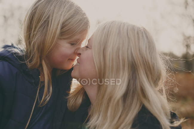 Mother and daughter touching noses — Stock Photo