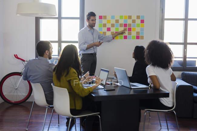 Businessman leading presentation — Stock Photo