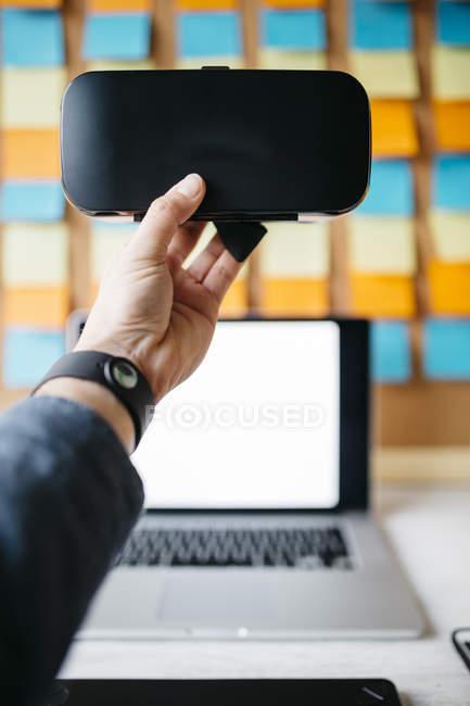 Hand holding virtual reality glasses — Stock Photo