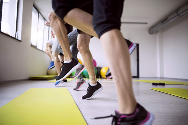Group of athletes exercising in gym — Stock Photo