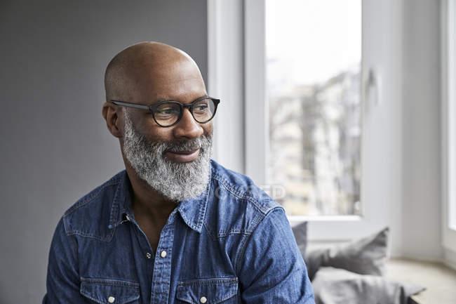 Portrait of smiling mature man — Stock Photo