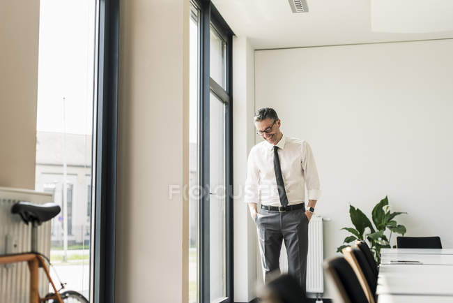 Businessman standing in conference room — Stock Photo