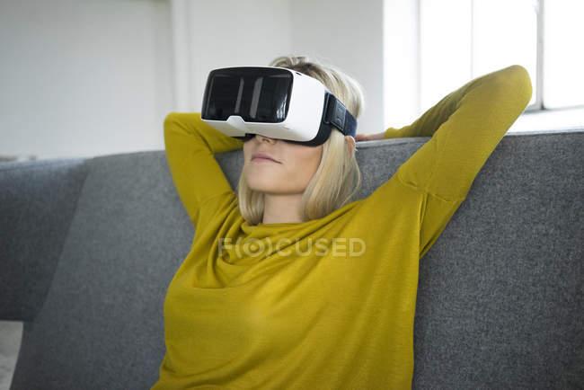Woman wearing virtual reality glasses — Stock Photo