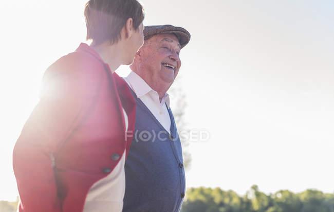 Senior man having fun with adult daughter — Stock Photo