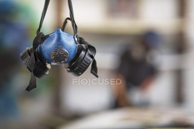 Protective mask hanging down — Stock Photo