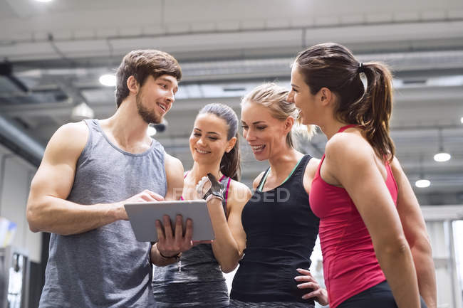 Athletes with tablet after exercising — Stock Photo