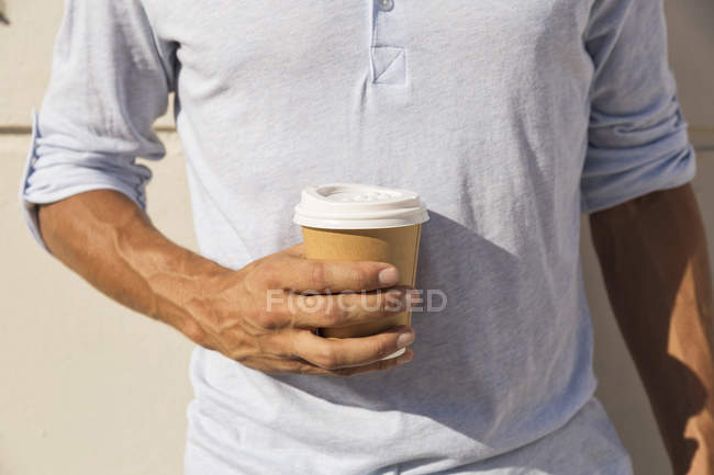 Man holding take away coffee — Stock Photo
