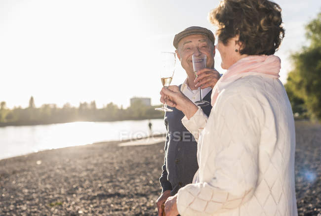 Couple toasting with sparkling wine — Stock Photo