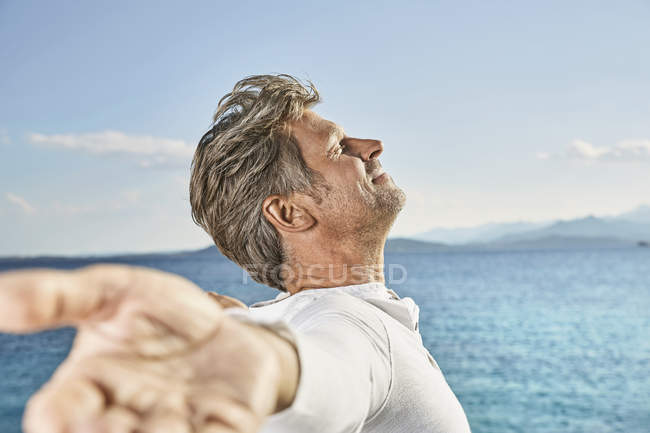 Mature man enjoying sunlight — Stock Photo