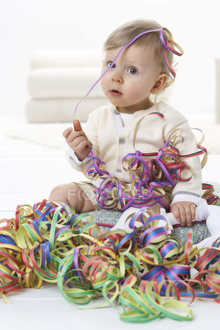 Toddler playing with streamers — Stock Photo