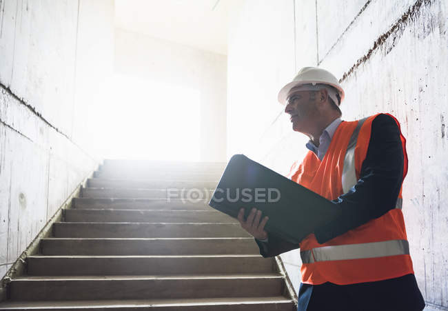 Man standing in building under construction — Stock Photo