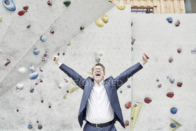 Businessman in bouldering hall — Stock Photo