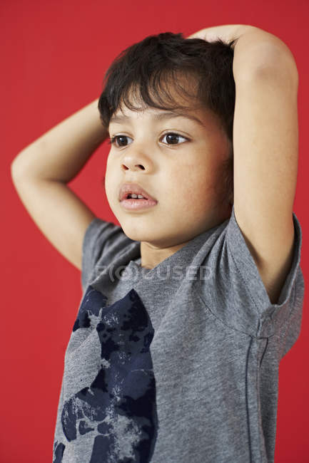 Boy with hands on his head — Stock Photo