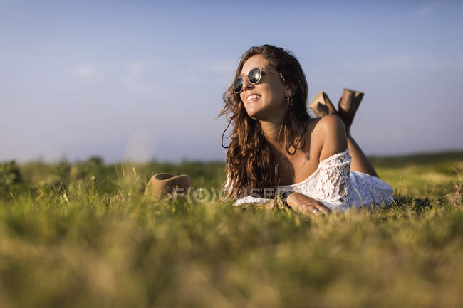 Woman lying on grass — стоковое фото
