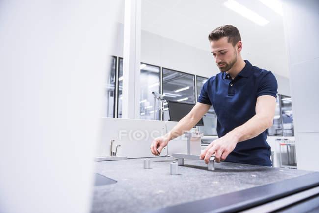 Man examining machine — Stock Photo