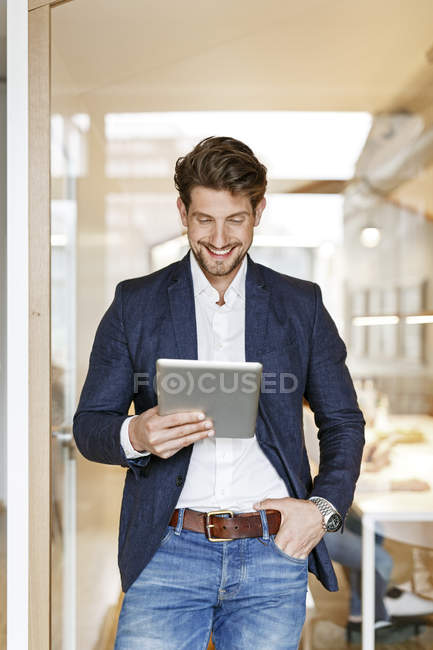 Businessmanusing digital tablet — Stock Photo