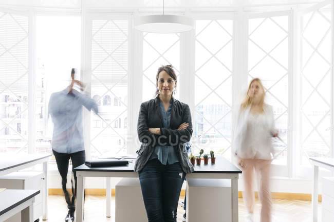 Woman in office startup with colleagues — Stock Photo