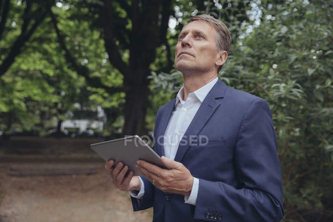 Business man with tablet computer — Stock Photo
