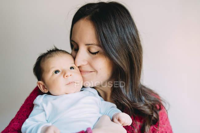 Mother holding newborn baby girl stock photo