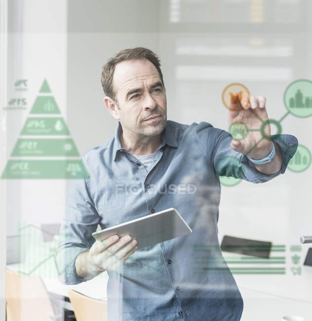 Portrait of mature businessman using digital screen — Stock Photo