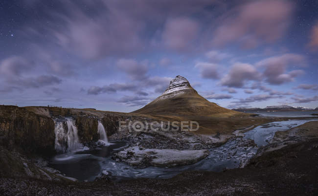 Iceland, kirkjufell, snaefells waterfall by the mountain in evening light — Stock Photo