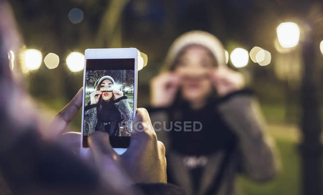 Man taking picture of his girlfriend pouting mouth — Stock Photo