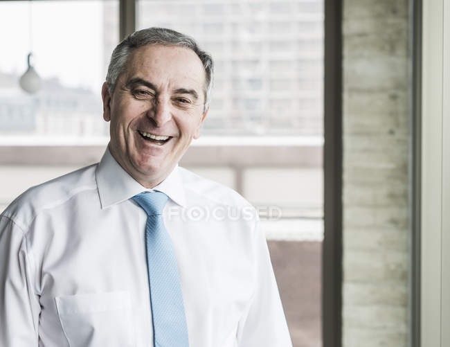 Senior manager standing in office — Stock Photo