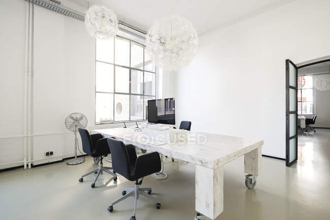 Interior of a modern agency office with furniture — Stock Photo