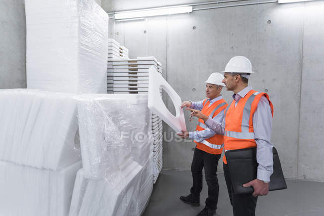 Colleagues examining polystyrene — Stock Photo
