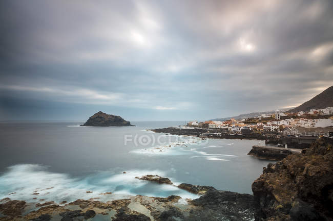 View of rocky coast against water  during daytime — Stock Photo