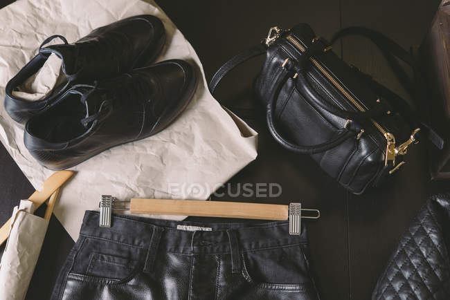 Black leather clothing on dark background — Stock Photo