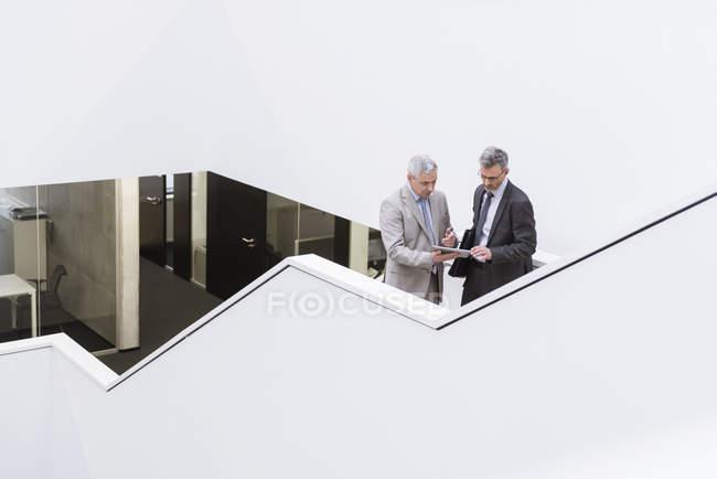 Businessmen using digital tablet — Stock Photo