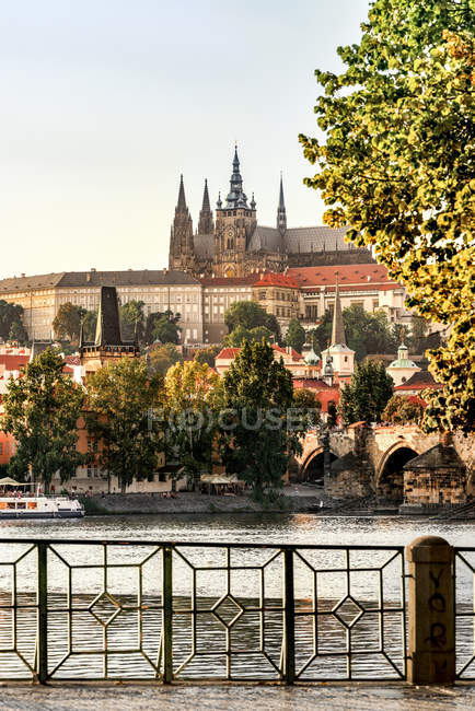 View of hishorical buisling against river during daytime, Germany — Stock Photo