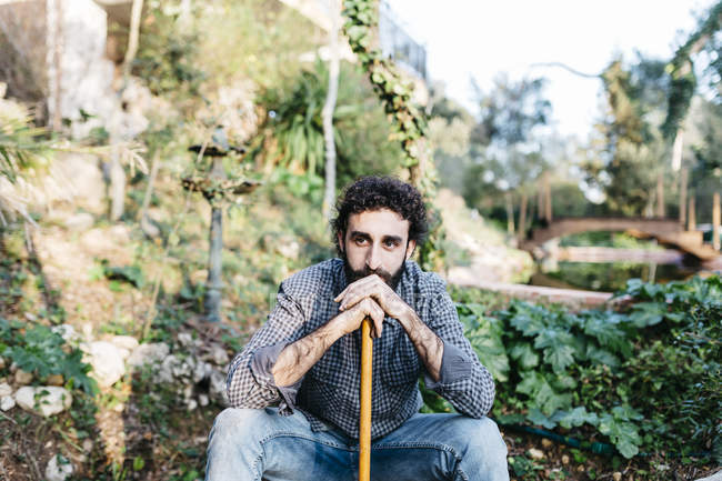 Man relaxing after work of gardening. — Stock Photo