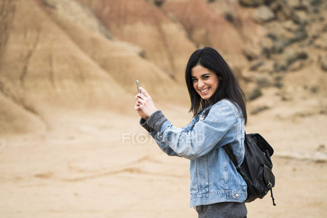 Woman taking selfie in nature park — Stock Photo