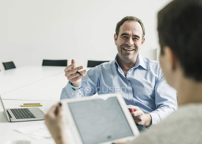 Cropped portrait of mature business colleagues at work — Stock Photo