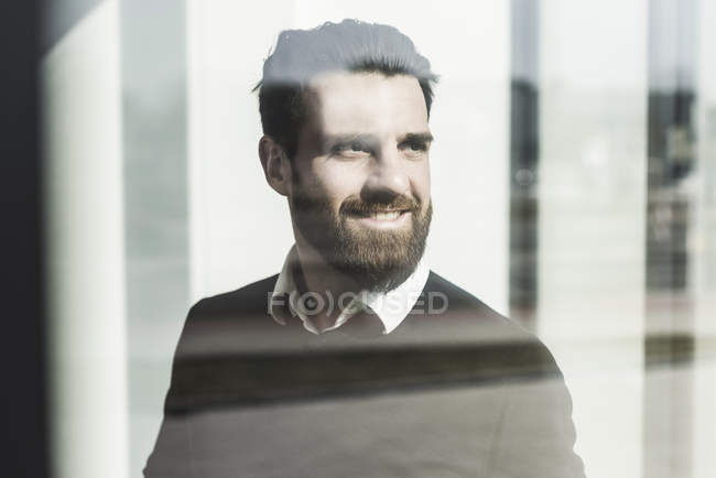 Portrait of young businessman looking aside — Stock Photo