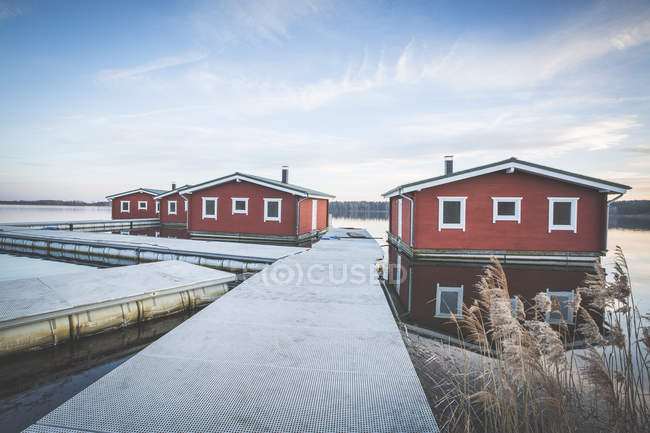 Germany, Saxony-Anhalt, Lake Bergwitz, floating rural houses with cloudy sky — Stock Photo