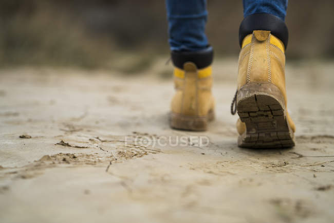 Hiking shoes walking in nature park — Stock Photo