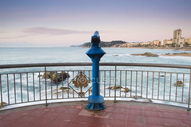 View of blue post against fence over water — Stock Photo