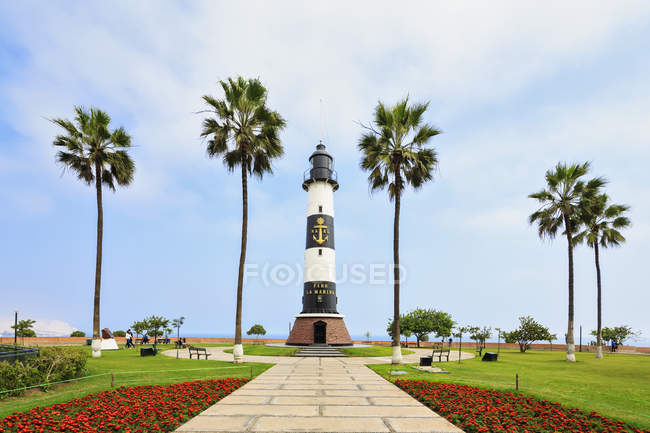 Peru, Lima, Lighthouse and palm trees during daytime — Stock Photo