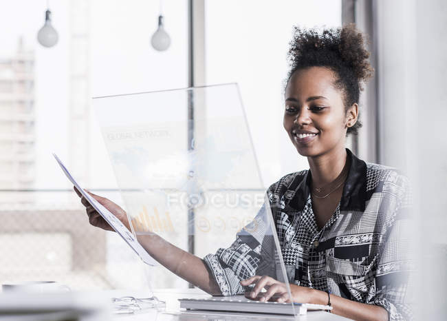 Woman using transparent computer — Stock Photo