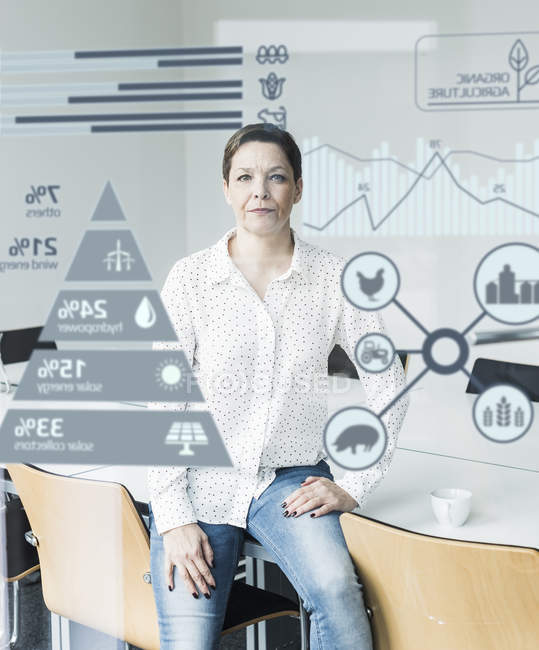 Portrait of mature businesswoman near digital screen — Stock Photo