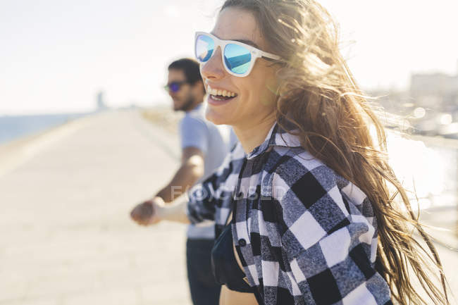 Cropped portrait of young couple walking on harbor — Stock Photo